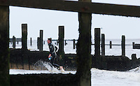 26 SEP 2010 - CLACTON, GBR - Colin Corby heads for transition after completing the sea swim at the Clacton Standard Distance Triathlon (PHOTO (C) NIGEL FARROW)