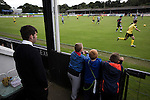 Young spectators in front of the main stand watching the action at Borough Briggs, home to Elgin City, on the day they played SPFL2 newcomers Edinburgh City (in yellow). Elgin City were a former Highland League club who were elected to the Scottish League in 2000, whereas Edinburgh City became the first club to gain promotion to the League by winning the Lowland League title and subsequent play-off matches in 2015-16. This match, Edinburgh City's first away Scottish League match since 1949, ended in a 3-0 defeat, watched by a crowd of 610.