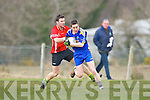 Paudie Quill St Senans goes past Con Godfrey Kilgarvan during their Novice Championship clash in Kilgarvan on Saturday
