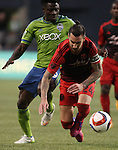 Seattle Sounders Obafemi Martins (9) and  Portland Timbers Liam Ridgewell (24) ball for ball control during an MLS match on April 26, 2015 at CenturyLink Field in Seattle, Washington.  Seattle Sounders Clint Dempsey scored a goal to give the Sounders a 1-0 victory over the Timbers. Jim Bryant Photo. ©2015. All Rights Reserved.