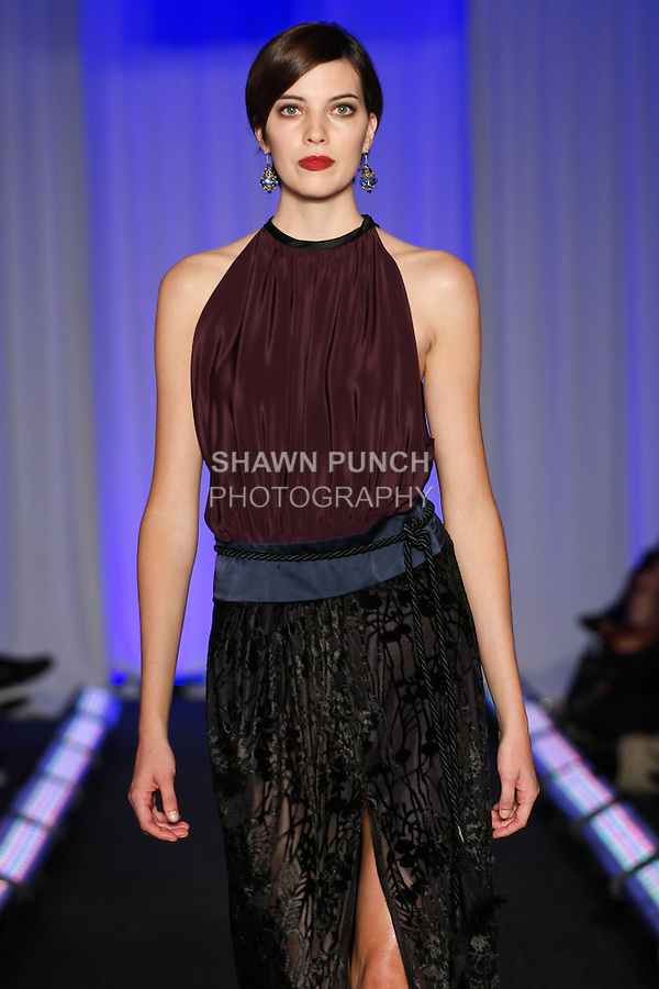 Model walks runway in an outfit by Andrea McInnes, for the Syracuse University, College of Visual and Peforming Arts 2011 Fashion Show Gala.