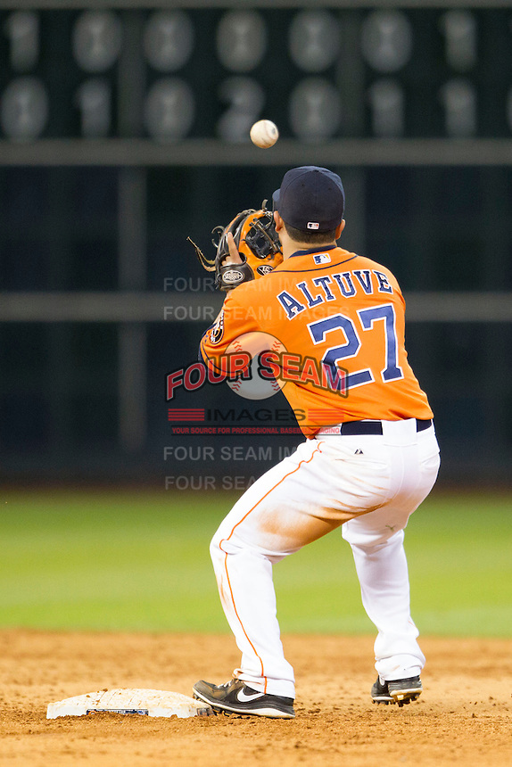 Houston Astros second baseman Jose Altuve (27) catches a toss from the shortstop during the MLB baseball game against the Detroit Tigers on May 3, 2013 at Minute Maid Park in Houston, Texas. Detroit defeated Houston 4-3. (Andrew Woolley/Four Seam Images).