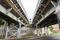 Converging tracks on a trestle over the street in Long Island City in Queens in New York on Saturday, September 6, 2014.  (© Richard B. Levine)