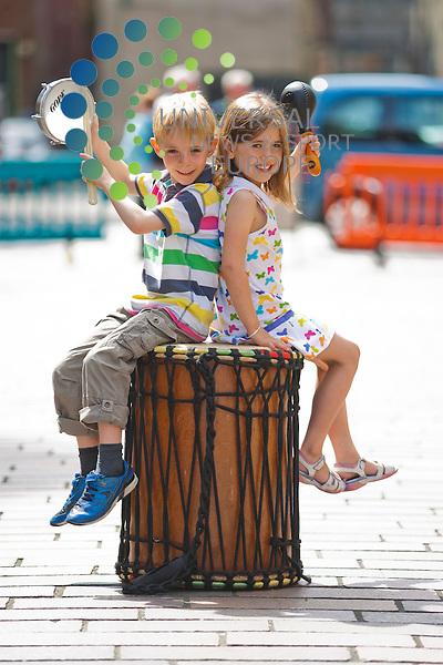 Youngsters open the Merchant City Festival. Six youngsters who have been participating in a three-day Rhythm Monztaz workshop will perform in a carnival parade. Pictured: Youngsters Callum, 7, and Stella, 7. 25th July 2012. Picture: Jonathan Faulds / Universal News And Sport (Europe)
