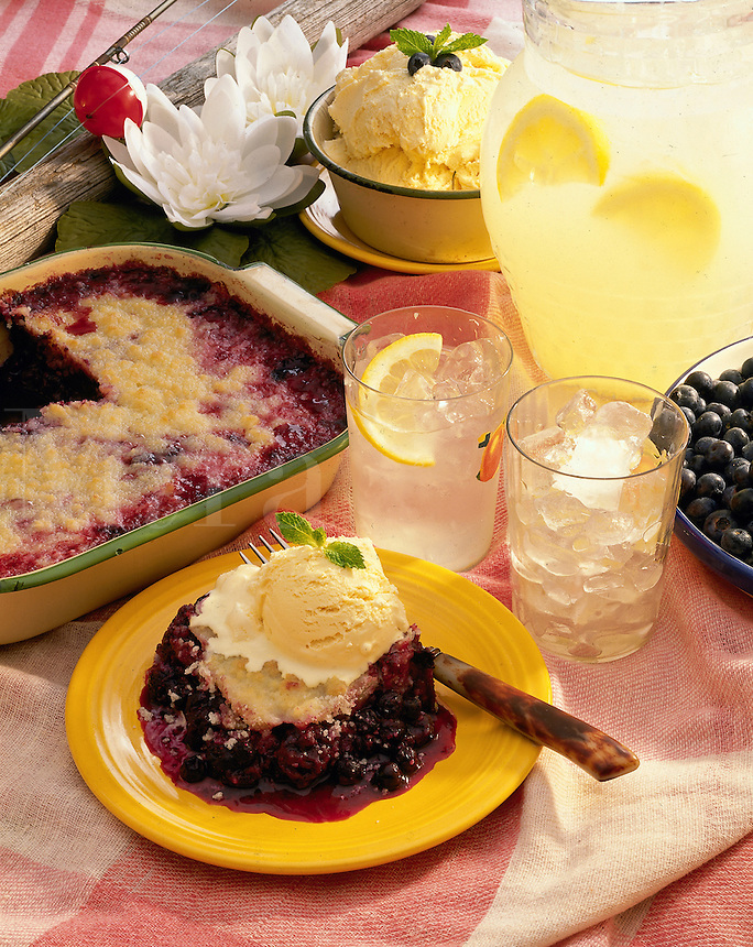Blueberry cobbler with ice cream and lemonade. Summer time picnic.