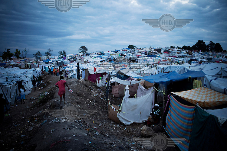 People displaced by the earthquake living in a camp on open ground..A 7.0 magnitude earthquake struck Haiti on 12/01/2010. Early reports indicated that more than 100,000 may have been killed and three million affected.