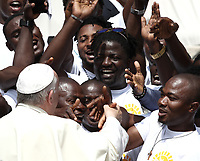 Papa Francesco saluta un gruppo di migranti durante l'udienza generale del mercoledi' in Piazza San Pietro, Citta' del Vaticano, 6 giugno, 2018.<br /> Pope Francis greets a group of migrants during his weekly general audience in St. Peter's Square at the Vatican, on June 6, 2018.<br /> UPDATE IMAGES PRESS/Isabella Bonotto<br /> <br /> STRICTLY ONLY FOR EDITORIAL USEUPDATE