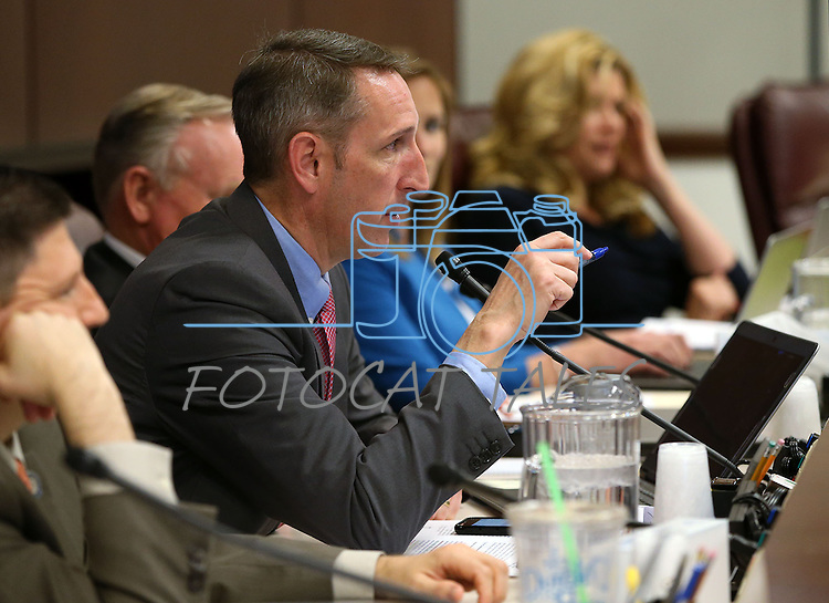 Nevada Sen. Scott Hammond, R-Las Vegas, works in committee at the Legislative Building in Carson City, Nev., on Tuesday, May 5, 2015.<br /> Photo by Cathleen Allison