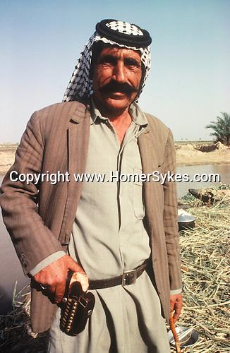 Marsh Arabs. Southern Iraq. Circa 1985. Marsh Arab man with gun. Haur al Mamar or Haur al-Hamar marsh collectively known now as Hammar marshes Irag 1984