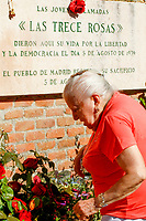 Paquita (92yo) , the oldest Communist Party veteran militant puts the bouquet roses at the monument.