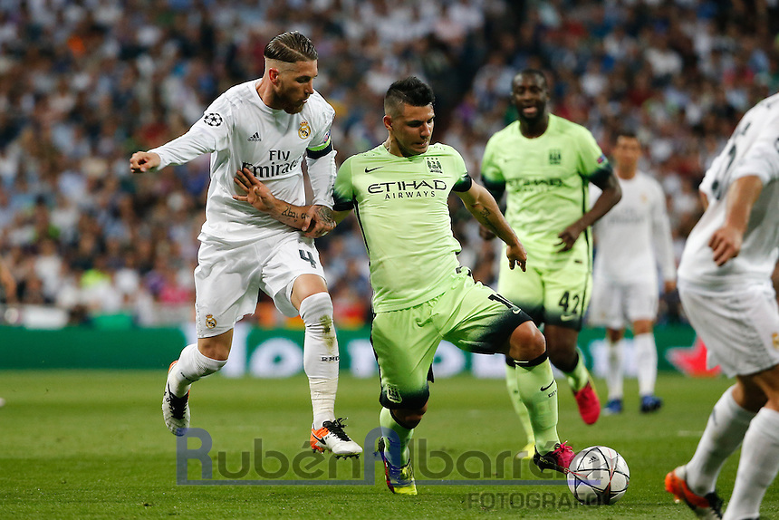 Manchester City&acute;s forward Sergio Aguero<br /> and Real Madrid&rsquo;s Spanish defense Sergio Ramos during the UEFA Champions League match between Real Madrid and Manchester City at the Santiago Bernabeu Stadium in Madrid, Wednesday, May 4, 2016.