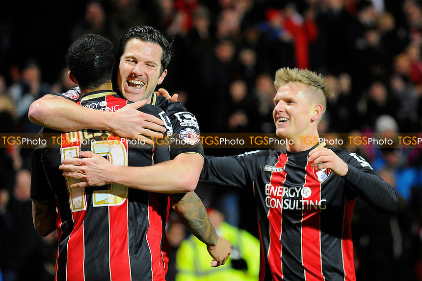 Yann Kermorgant of AFC Bournemouth hugs Callum Wilson of AFC Bournemouth after scoring the opening goal  - AFC Bournemouth vs Wolverhampton Wanderers - Sky Bet Championship Football at the Goldsands Stadium, Bournemouth, Dorset - 03/03/15 - MANDATORY CREDIT: Denis Murphy/TGSPHOTO - Self billing applies where appropriate - contact@tgsphoto.co.uk - NO UNPAID USE