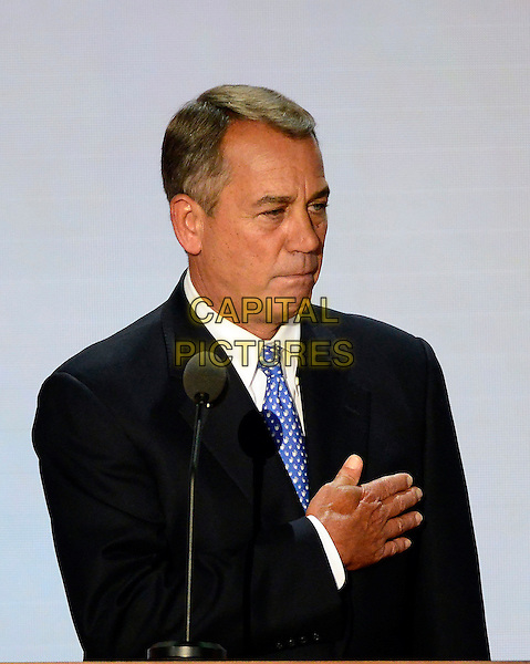 Speaker of the United States House of Representatives John Boehner (Republican of Ohio) listens to the National Anthem at the start of Day 4 of the 2012 Republican National Convention, Tampa Bay, Florida, USA..30th August 2012.half length black suit blue tie hand on chest .CAP/ADM/CNP/RS.©Ron Sachs/CNP/AdMedia/Capital Pictures