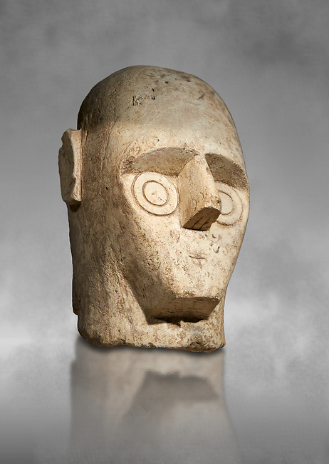 9th century BC Giants of Mont'e Prama Nuragic stone head from the statue of a boxer, Mont'e Prama archaeological site, Cabras. Museo archeologico nazionale, Cagliari, Italy. (National Archaeological Museum) - Grey Art Background