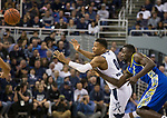 Nevada forward  Tre'Shawn Thurman (0) looks to catch a pass against as San Jose State center Oumar Barry (13) defenses in the second half of an NCAA college basketball game in Reno, Nev., Wednesday, Jan. 9, 2019. (AP Photo/Tom R. Smedes)