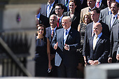 United States President Donald J. Trump poses for a group photo with a group of National Security Council staff members on the steps of the Eisenhower Executive Office Building in Washington, DC on Thursday, September 28, 2017.  Pictured with the President are Dina Powell, Deputy National Security Advisor for Strategy, left, and H.R. McMaster, National Security Advisor, right.<br /> Credit: Alex Edelman / CNP