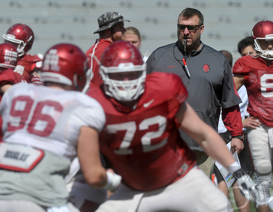 NWA Democrat-Gazette/MICHAEL WOODS &bull; @NWAMICHAELW<br /> University of Arkansas head coach Bret Bielema works with the Razorbacks April 9, 2016, during practice at Razorback Stadium.