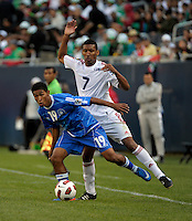 El Salvador's Reynaldo Hernandez evades the challenge by Cuba's Marcel Hernandez.  El Salvador defeated Cuba 6-1 at the 2011 CONCACAF Gold Cup at Soldier Field in Chicago, IL on June 12, 2011.