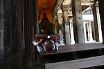 An elderly man takes a nap inside the central temple complex at Angkor Wat, Cambodia. June 7, 2013.
