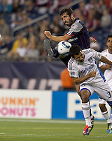 New England Revolution midfielder Monsef Zerka (19) takes a shot as San Jose Earthquakes defender Steven Beitashour (33) defends. In a Major League Soccer (MLS) match, the San Jose Earthquakes defeated the New England Revolution, 2-1, at Gillette Stadium on October 8, 2011.