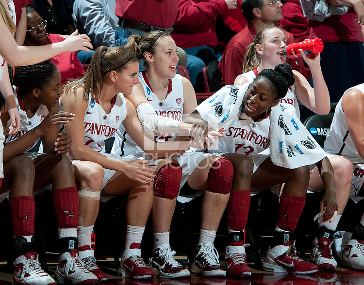 STANFORD, CA - March 21, 2011: Stanford Cardinal's Chiney Ogwumike, Kayla Pedersen, and Jeanette Pohlen during Stanford's 75-51 win over St. John's during the second round of the NCAA tournament at Maples Pavilion in Stanford, California.