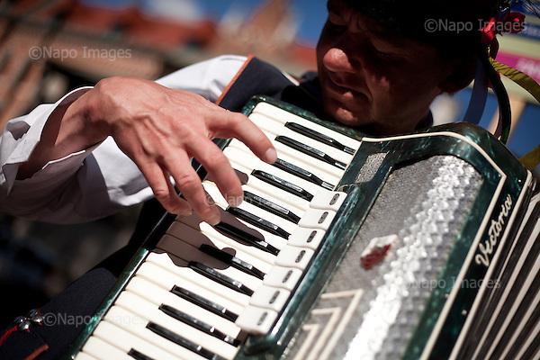 KRAKOW, POLAND, SEPTEMBER 12, 2011:.Adam Wasek is playing accordion to earn money from tourist, by Wawel castle in central Krakow..(Photo by Piotr Malecki / Napo Images) ..KRAKOW, 9/2011:.Krakowiak Adam Walasek gra na akordeonie..Fot: Piotr Malecki / Napo Images