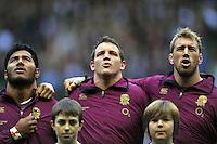 Manu Tuilagi, Tom Johnson and Chris Robshaw sing the national anthem. QBE International match between England and Australia on November 17, 2012 at Twickenham Stadium in London, England. Photo by: Patrick Khachfe / Onside Images