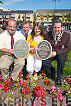 BEST KEPT TOWN: Members of Killarney UDC celebrate winning the Tidy Towns Best Kept Town award in Killarney on Tuesday. L-r: Kevin Malley (town clerk), David Doyle (town engineer), Margaret Pigott and Niall OCallaghan (mayor of Killarney). .