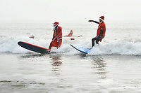 2017 12 24 Santa surfers in Langkand Bay, Wales, UK