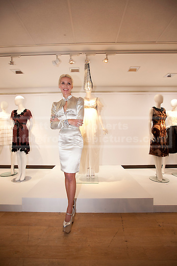 21/06/2012. LONDON, UK. Fashion muse Daphne Guinness stands in front of an Alexander McQueen dress (Est: £15,000-20,000) designed for her by the late fashion designer ahead of an auction at Christies South Kensington Auction House in London today (21/0612).  The auction, held in aid of The Isabella Blow Foundation, features 102 lots of shoes, clothes and photographs from Daphne Guinness's private collection and is expected to realise in the region of £100,000 when it takes place on the evening of the 27th of June. Photo credit: Matt Cetti-Roberts