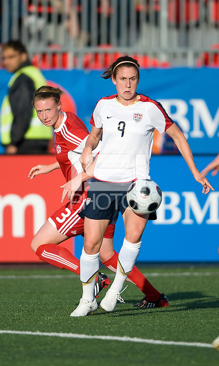 25 May 09:  USA National midfielder Heather O'Reilly #9 and Canadian National defender Melanie Booth #3 in action in an International Friendly soccer game between the US Women's Team and the Canadian Women's Team at BMO Field in Toronto..The US Women's Team won 4-0..