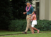 Washington, DC - June 25, 2009 -- United States President Barack Obama dances while walking out of the Oval Office with his daughter Sasha, 8, to join a luau for members of Congress and their families on the South Lawn of the White House June 25, 2009 in Washington, DC. In a celebration of the president's home state, the South Lawn was decorated with tiki torches and palm huts and the meal prepared by famous Hawaiian chef Alan Wong. .Credit: Chip Somodevilla - Pool via CNP
