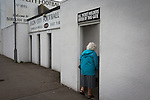 A home supporter arriving at Borough Briggs, home to Elgin City, on the day they played SPFL2 newcomers Edinburgh City. Elgin City were a former Highland League club who were elected to the Scottish League in 2000, whereas Edinburgh City became the first club to gain promotion to the League by winning the Lowland League title and subsequent play-off matches in 2015-16. This match, Edinburgh City's first away Scottish League match since 1949, ended in a 3-0 defeat, watched by a crowd of 610.