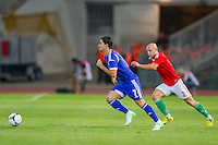 Israel's Beram Kayal (L) and Hungary's Jozsef Varga (R) fights for the ball during a friendly football match Hungary playing against Israel in Budapest, Hungary on August 15, 2012. ATTILA VOLGYI