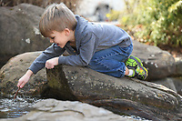NWA Democrat-Gazette/J.T. WAMPLER A.J. O'Bryan, 5, plays Sunday Jan 6, 2019 on the water feature on the Fayetteville Square. A.J. was playing with his brother Sinclair, 3, and his dad Will O'Bryan of Fayetteville. According to the National Weather Service, warm temperatures and sunny skies will be lingering this week.