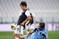 20th July 20202, Allianz Stadium, Turin, Italy; Serie A football league, Juventus versus Lazio;  Paulo Dybala holds off the challenge from Francesco Acerbi of lazio