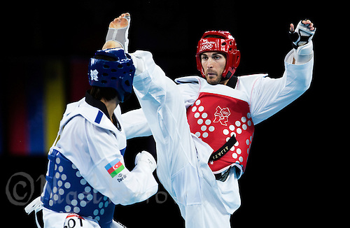 10 AUG 2012 - LONDON, GBR - Mauro Sarmiento (ITA) (right) of Italy aims a kick at Ramin Azizov of Azerbaijan during their men's -80kg category quarter final contest at the London 2012 Olympic Games Taekwondo at Excel in London, Great Britain .(PHOTO (C) 2012 NIGEL FARROW)