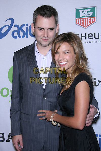 ZACH HELM & KIELE SANCHEZ .Oxfam Annual Cocktail Party - Arrivals held at The Esquire House 360, Beverly Hills, California, USA..November 29th, 2006.half length black dress blue suit jacket.CAP/ADM/ZL.©Zach Lipp/AdMedia/Capital Pictures