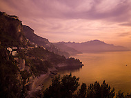 A beautiful sunset turns this view of the Amalfi Coast purple and orange