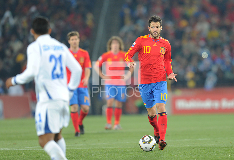Spanish substitute midfielder Cesc Fabregas builds the attack. Spain defeated Honduras, 2-0, in their second match of play in Group H  in a match played Monday, June 21st, at Ellis Park in Johannesburg, South Africa at the 2010 FIFA World Cup..