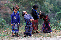 Laos, Udom Xai Province, Na Mor..Hmong girls having fun...Photo by Kees Metselaar, 2003