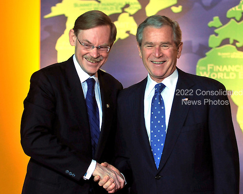 Washington, D.C. - November 15, 2008 -- United States President George W. Bush welcomes Robert B. Zoellick, President of the World Bank to the Summit on Financial Markets and the World Economy leaders to the National Building Museum in Washington, D.C. on Saturday, November 15, 2008..Credit: Ron Sachs / Pool via CNP