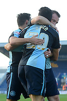 Wycombe Wanderers Luke O'Nien celebrates his opening goal with team mates Sam Wood and Garry Thompson during the Sky Bet League 2 match between Mansfield Town and Wycombe Wanderers at the One Call Stadium, Mansfield, England on 31 October 2015. Photo by Garry Griffiths.