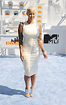 LOS ANGELES, CA - APRIL 12:  Actress/model Amber Rose arrives at the 2015 MTV Movie Awards at Nokia Theatre L.A. Live on April 12, 2015 in Los Angeles, California.
