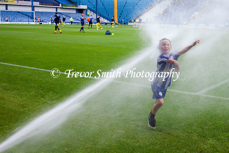 Sheffield Wednesday v Millwall 24.8.13 .... A young Sheffield Wednesday mascot gets a cooling off at todays entertaining game!<br /> <br /> Picture Trevor Smith/Trevor Smith Photography Ltd