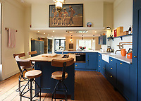 BNPS.co.uk (01202 558833)<br /> Pic: LillicrapChilcott/BNPS<br /> <br /> Fab Four poster on the wall in the kitchen/breakfast room.<br /> <br /> I predict a riot of potential home owners flocking to the Falmouth home of Kaiser Chiefs frontman Ricky Wilson.<br /> <br /> The harbourside mansion has been put up for sale with a £1.5 million asking price after the Yorkshire band have gone back on the road.<br /> <br /> Regency era Stratton House is not very Rock'n'Roll but it does contain a Great Escape replica motorbike that Wilson has never actually ridden having failed his test twice.