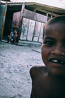 A child plays on the street.