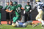 Torrance, CA 10/06/11 - Andrew Phillips (Peninsula #11) and unidentified South Torrance player(s) in action during the Peninsula vs South Torrance Frosh football game.