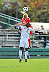 12 October 2011: University of Vermont Catamount Defender Yannick Lewis, a Senior from Toronto, Ontario, jumps against Sanford Spivey in action against the Boston University Terriers at Centennial Field in Burlington, Vermont. The Catamounts were edged out 1-0 by the visiting Terriers. Mandatory Credit: Ed Wolfstein Photo