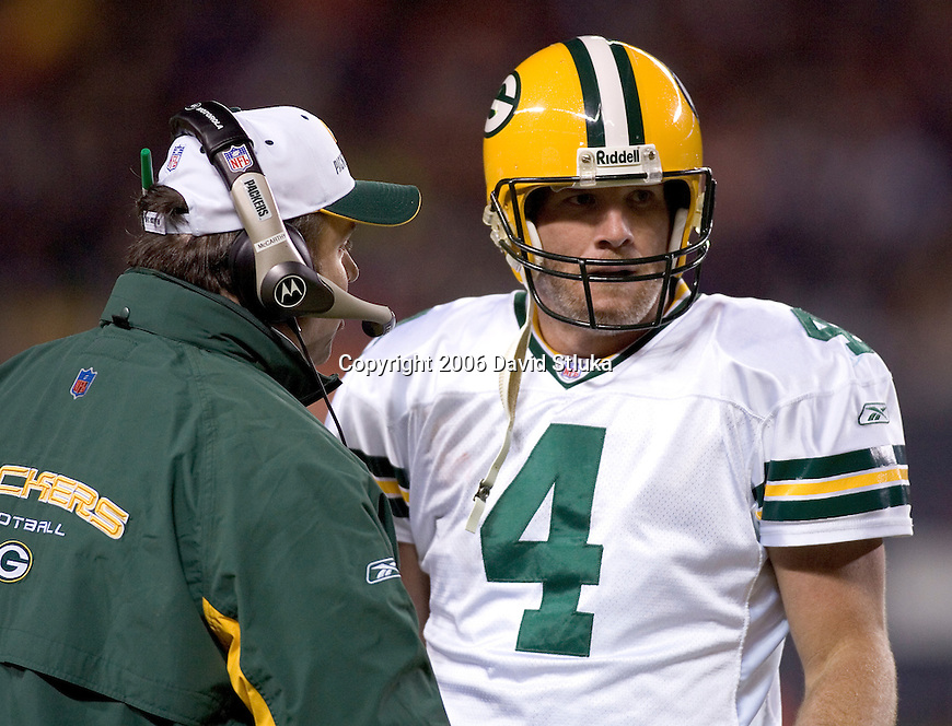 Head coach Mike McCarthy talks to quarterback Brett Favre #4 of the Green Bay Packers during the game during an NFL football game against the Chicago Bears at Soldier Field on December, 2006 in Chicago, Illinois. The Packers defeated the Bears 26-7. (Photo by David Stluka)
